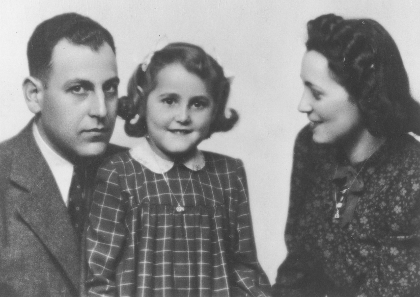 Portrait of a Jewish family in Prague.  Pictured from left to right are: Karel, Alena and Marta Pekova.