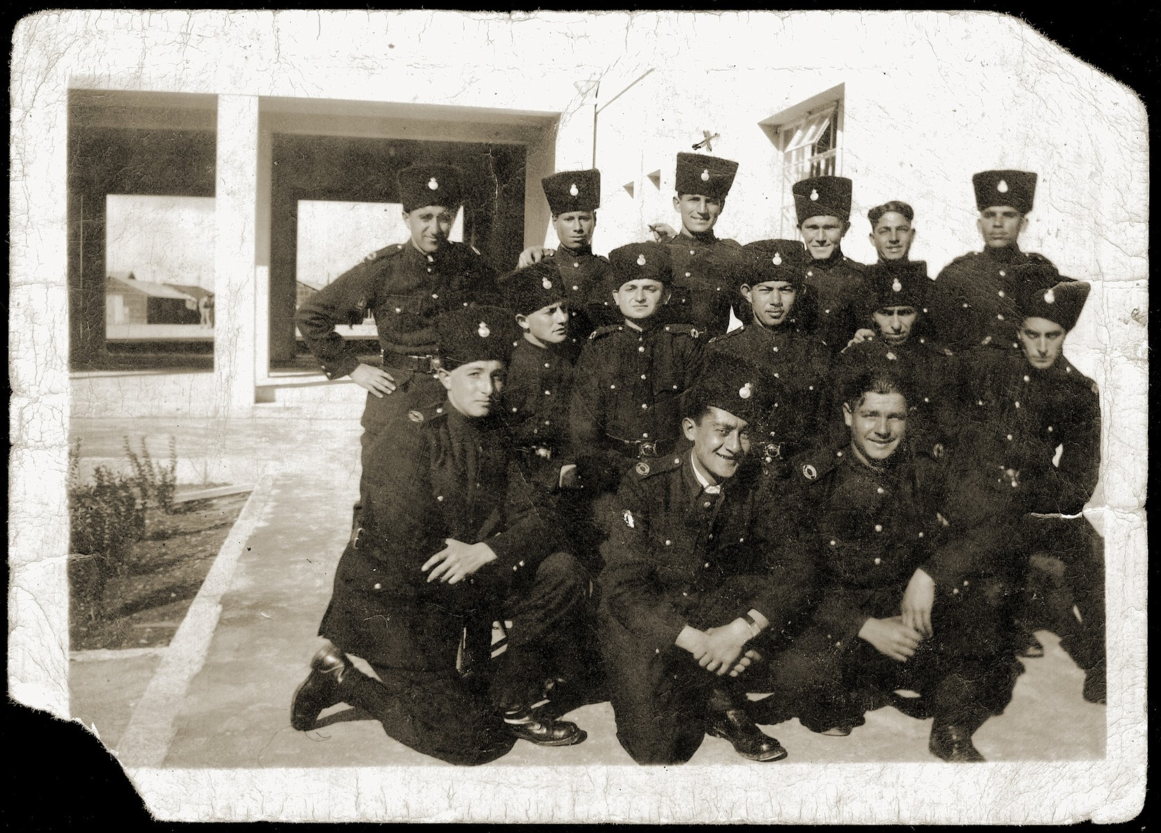 Group portrait of members of the British mandate police force in Haifa.    Among those pictured is Mordechai Schwarcz.