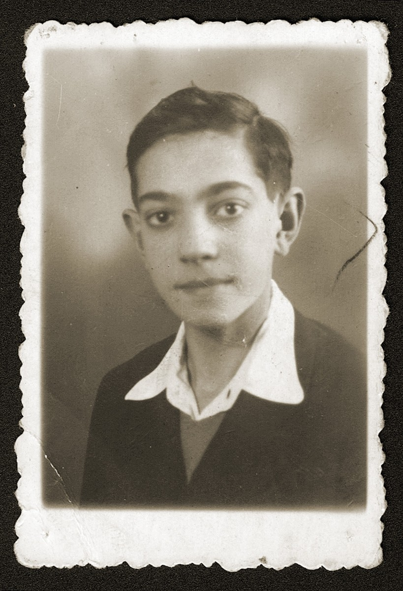 Studio portrait of a Jewish youth, Szymek Fiszel.    He was deported to Auschwitz and perished there at the age of fifteen.