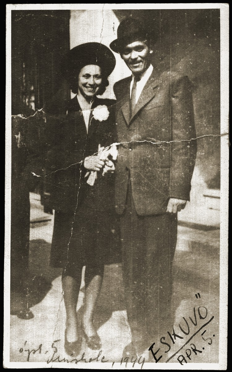Wedding portrait of Miriam Schwarcz and Bela Rosenthal.  Miriam is covering the yellow star with her arm.