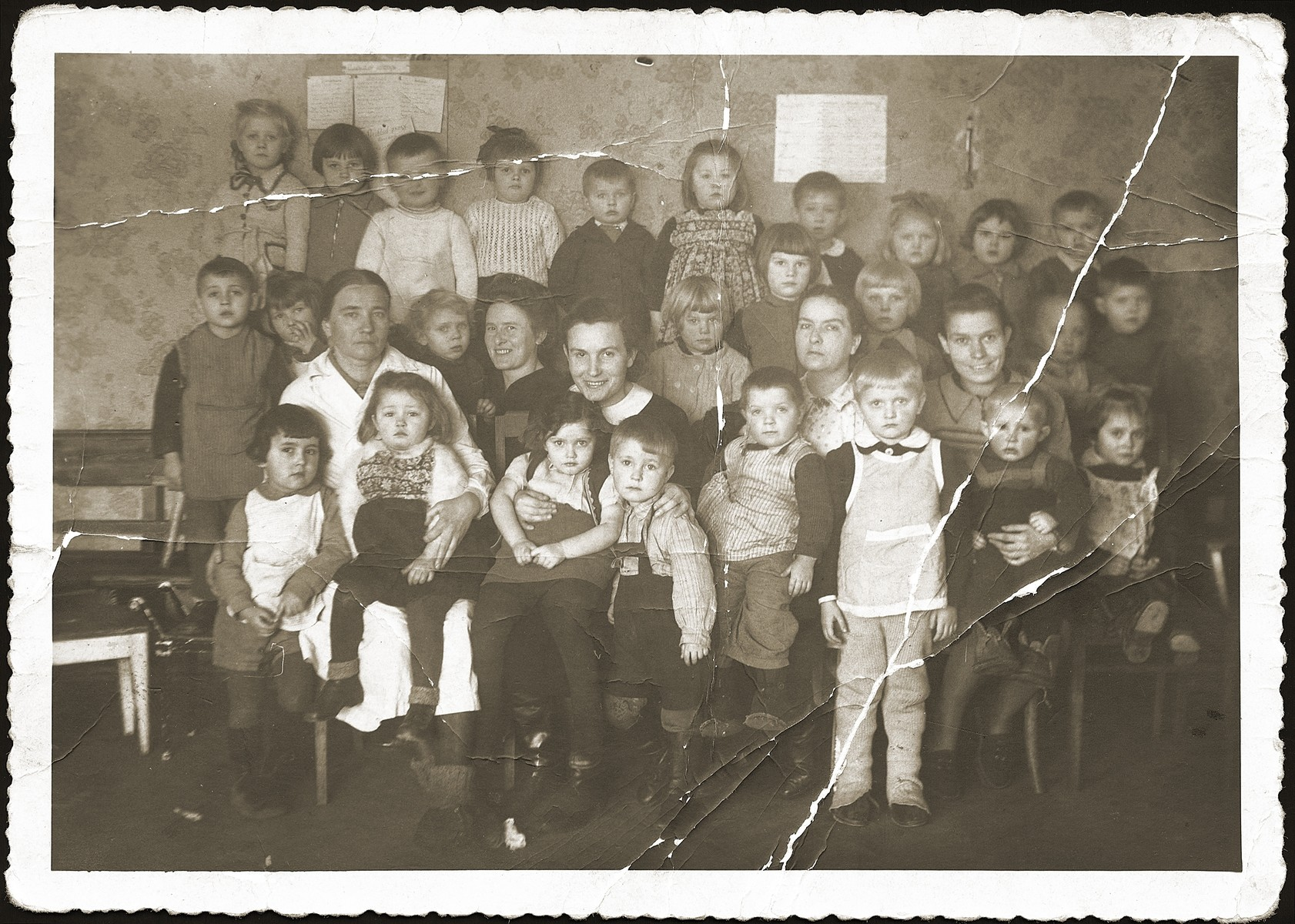Group portrait of teachers and pupils of a Polish kindergarten in Bialystok.    Among those pictured is Anna Strzelczyk (front row, third from the left).
