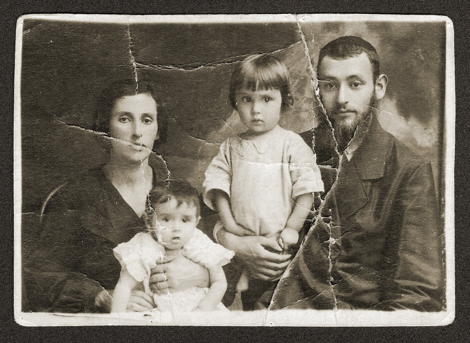 The Rubinsztejn family.  Chaya Ester and Hersh Yitzhak hold their sons, Abraham Baer, left, and  Szamuel Chaim.