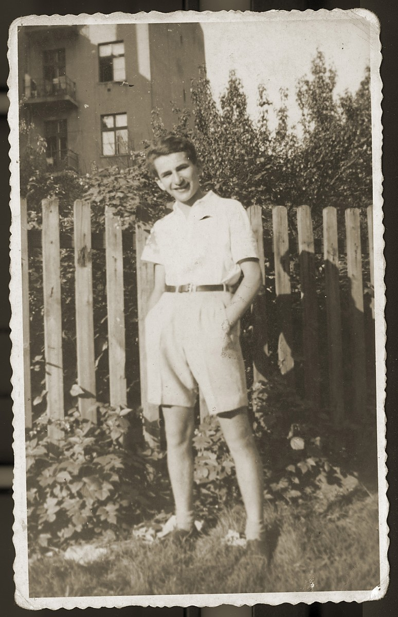 "Portrait of a Jewish youth wearing shorts in the Bedzin ghetto.  Pictured is Zygmunt Pluznik.  Pluznik gave this photo to his friend, Idziek Gold, before Idziek departed Bedzin for the Ilag Tittmoning international camp.  Pluznik inscribed his picture, ""To my dear Idziek on the last days of our friendship.""  The photo bears the stamp of Ilag Tittmoning, where all personal possessions were registered and stamped upon arrival.   His mother, Dora Pluznik, and his two sisters, Mania and Rozia,  were deported and killed in Auschwitz in August 1943, as were Rozia's husband and daughter."