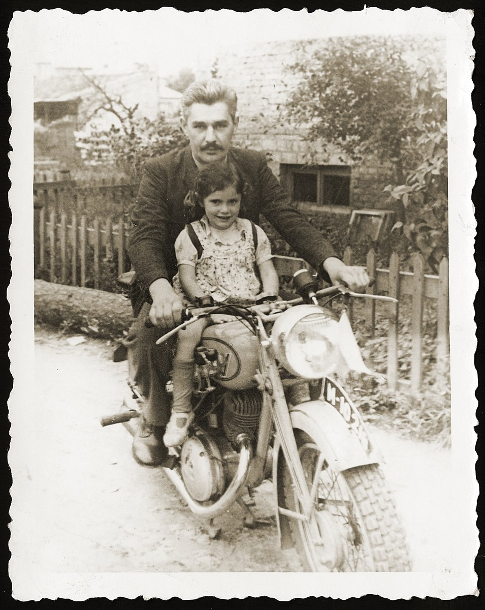 Anna Strzelczyk sits on a motorcycle with Michal Kempinski, who smuggled her out of the Bialystok ghetto.