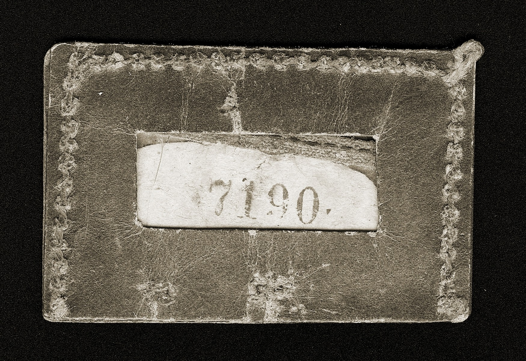 An identification tag issued to Gina Tabaczynska, when she was detained with other employees of the Schultz & Co. factory in the Warsaw ghetto in the summer of 1942.  Those who held these numbers were presumed to be exempt from deportation.