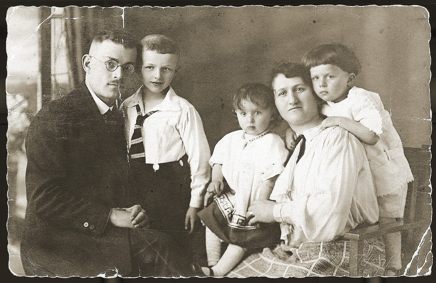 Portrait of the Gruengras family.    Pictured from left to right are: Nachman, Josef David, Frieda, Ester and Isidor Gruengras.