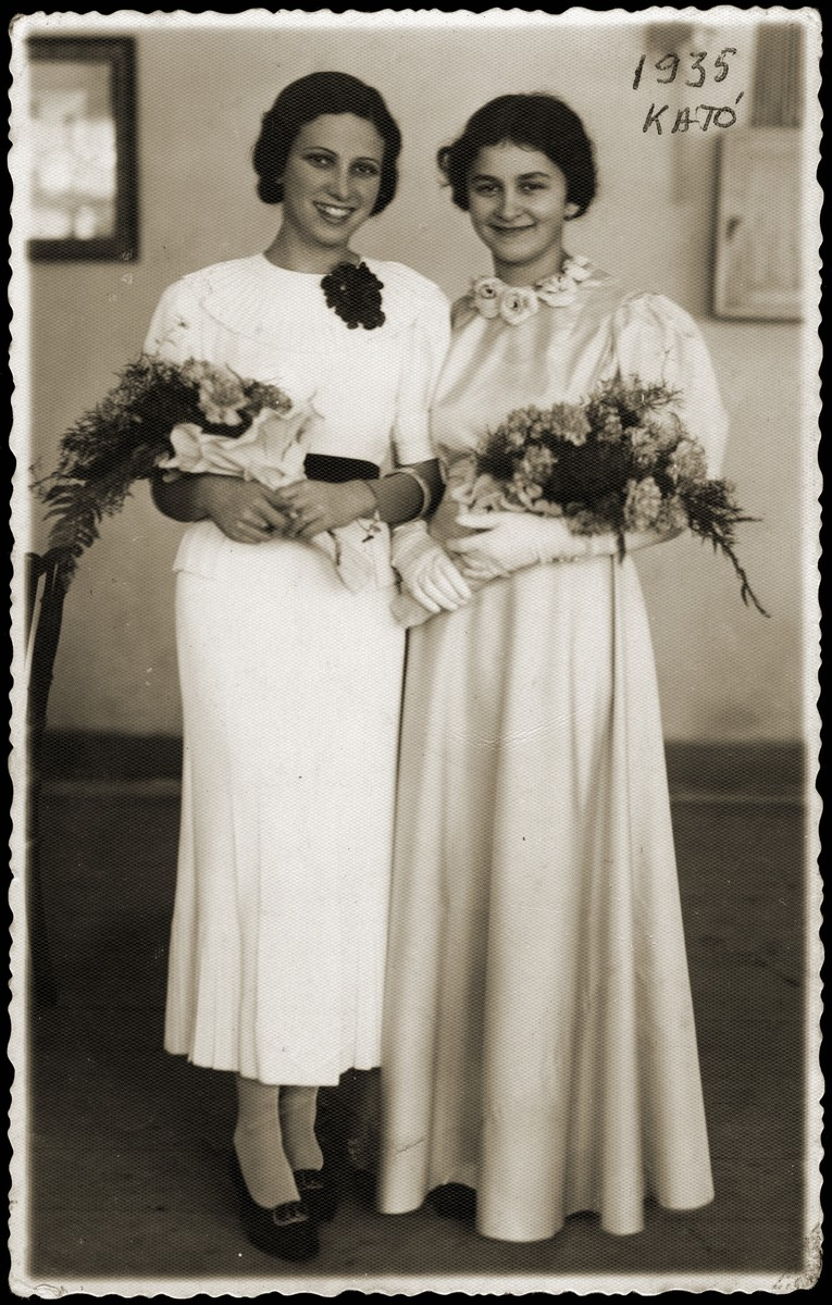 Two bridesmaids pose with bouquets of flowers at the wedding of the donor's sister, Ella Schwarcz.    Pictured are the donor's sister, Aranka Schwarcz, and Kato Fleischmann, the sister of the groom.