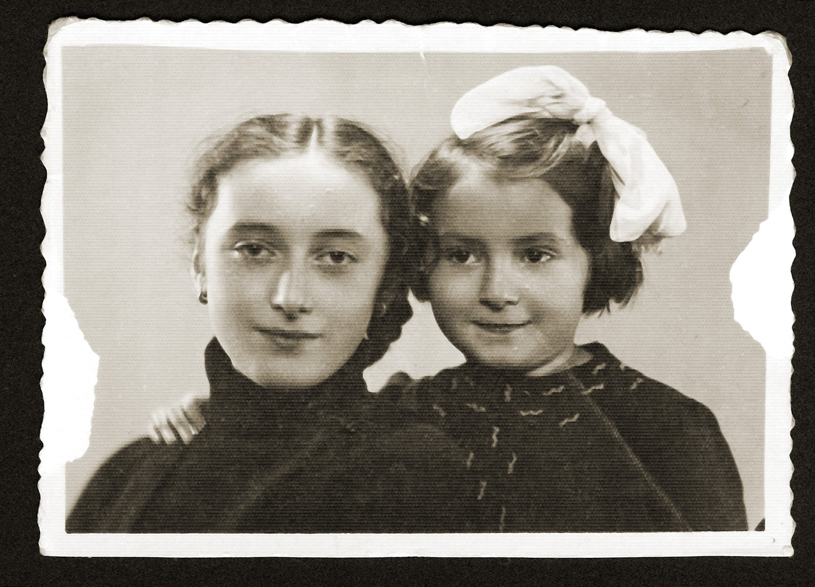 Studio portrait of two Jewish girls in the Bedzin ghetto.  Pictured are Maniusia Gipsman (left) and her cousin, Dina.  Both girls perished in Auschwitz.  Maniusia was 13 years old at the time of her death.