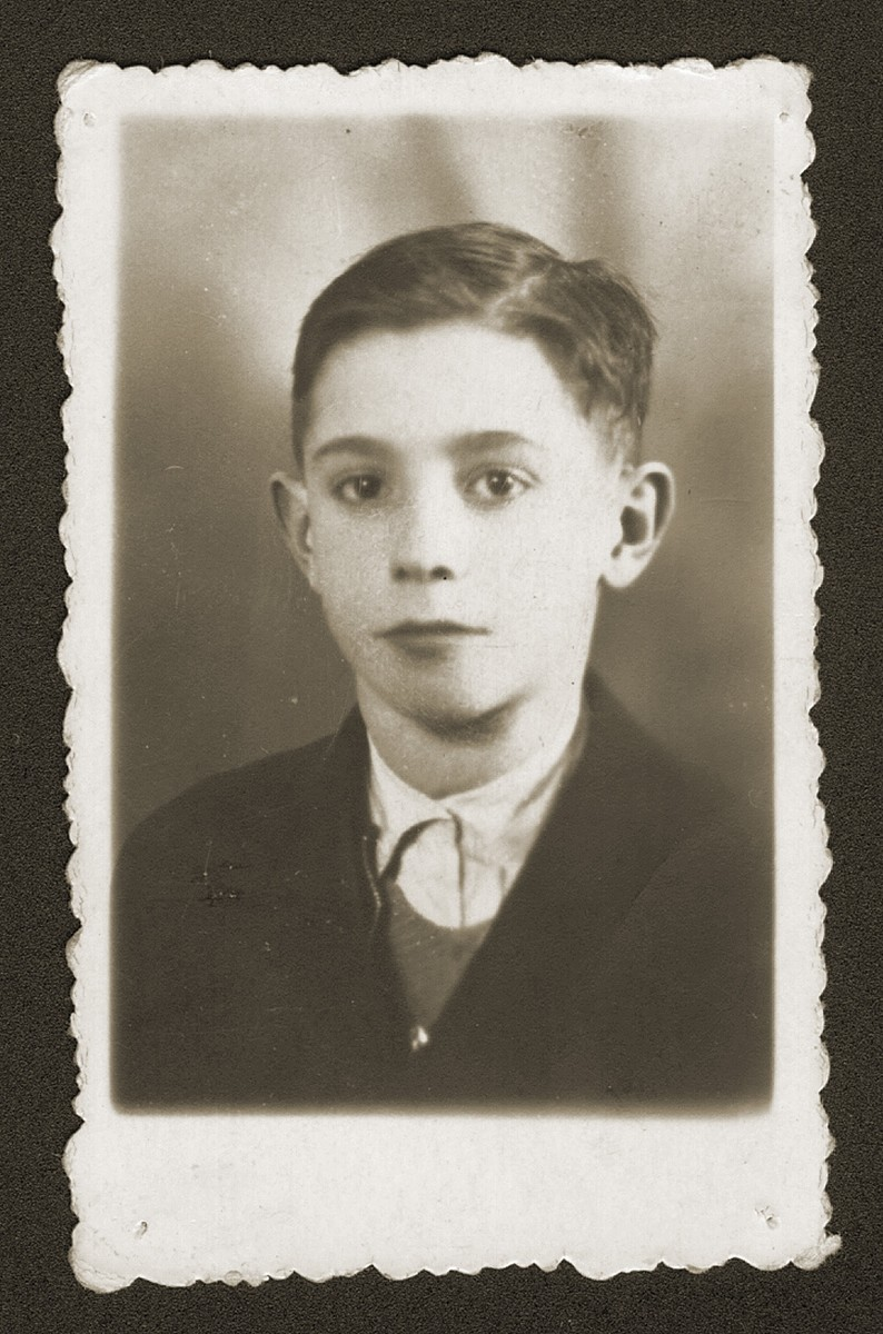Studio portrait of a Jewish youth, Kalman Fiszel.    He was deported to Auschwitz in August 1943 and perished there at the age of thirteen.