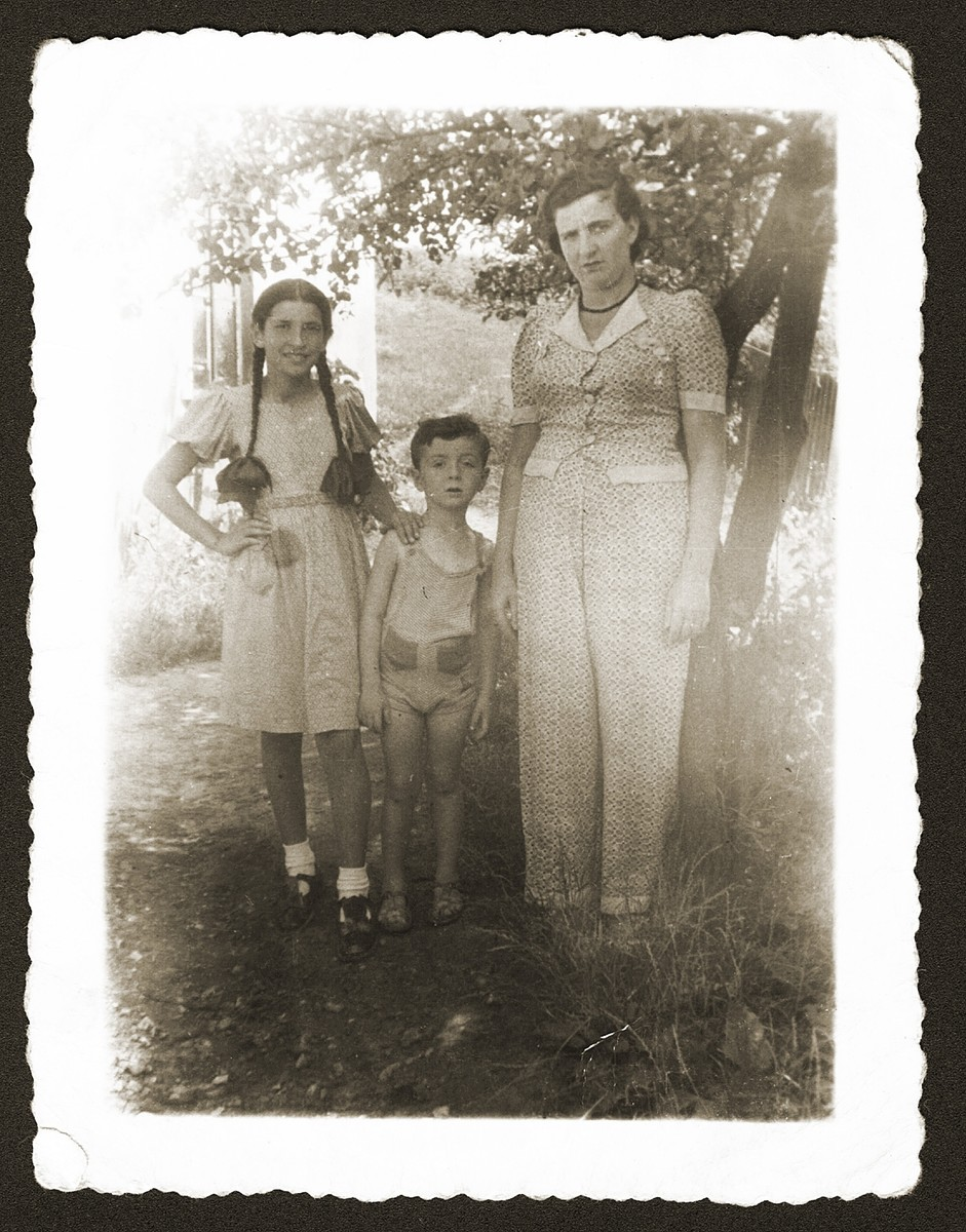 A Jewish girl, Fela Fiszel (left) poses with her aunt, Fajga Einesman, and cousin, Monius, during a summer vacation in Olkusz, Poland.