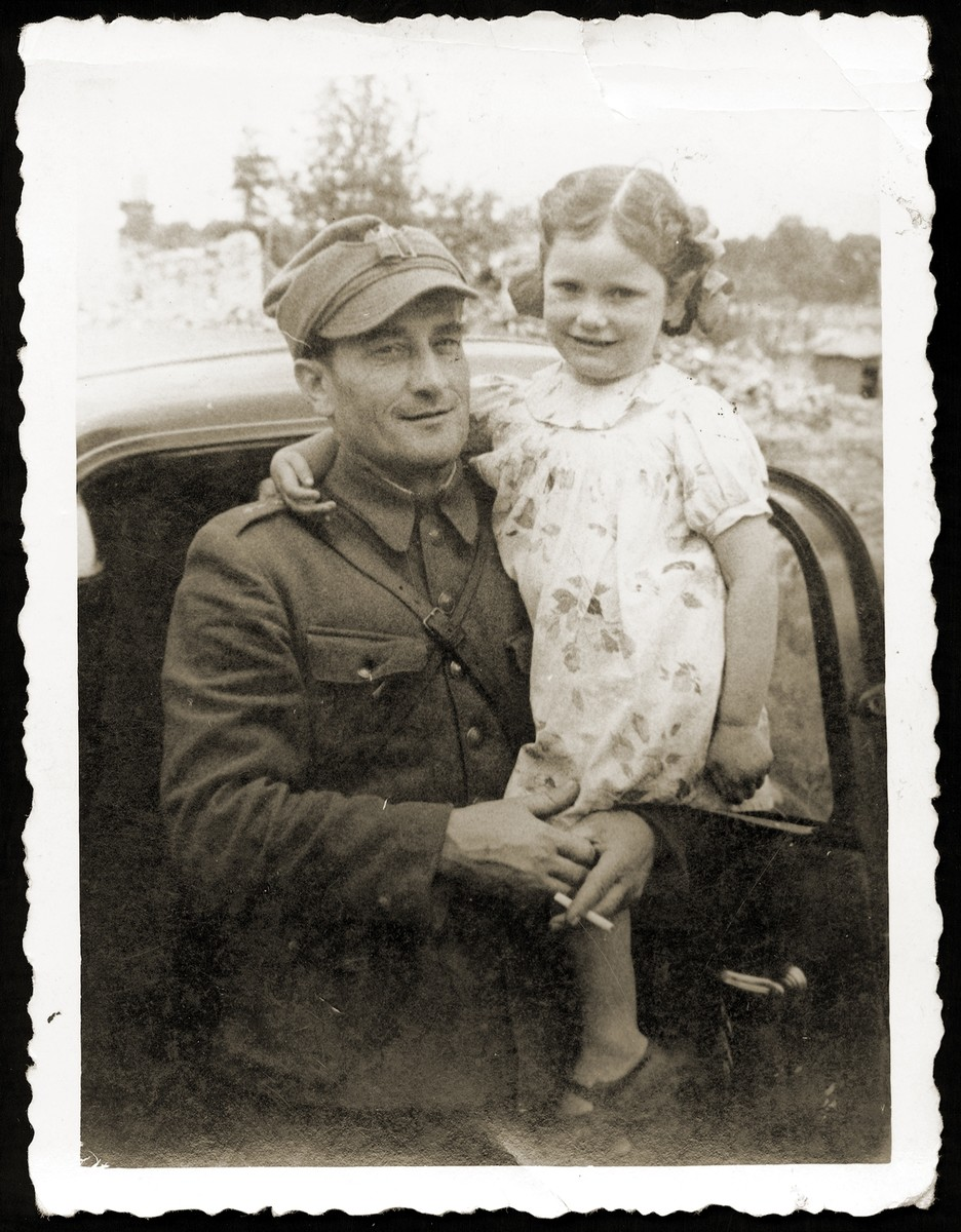 Anna Strzelczyk poses in the arms of her Polish rescuer and adopted father, Tadeusz Strzelczyk, after the war.