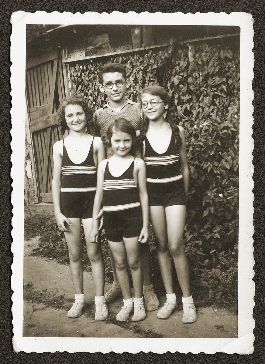 Dworja Raca Rubinsztejn, right, with her brother, Armand, and cousins, Denise and Eveline Grynberg, on vacation in the French countryside.