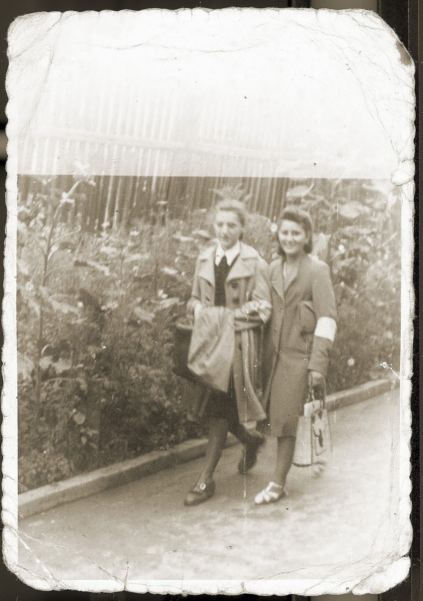 Fredzia Gruengras (the donor's sister) and a friend, walk down a street in the Bedzin ghetto.