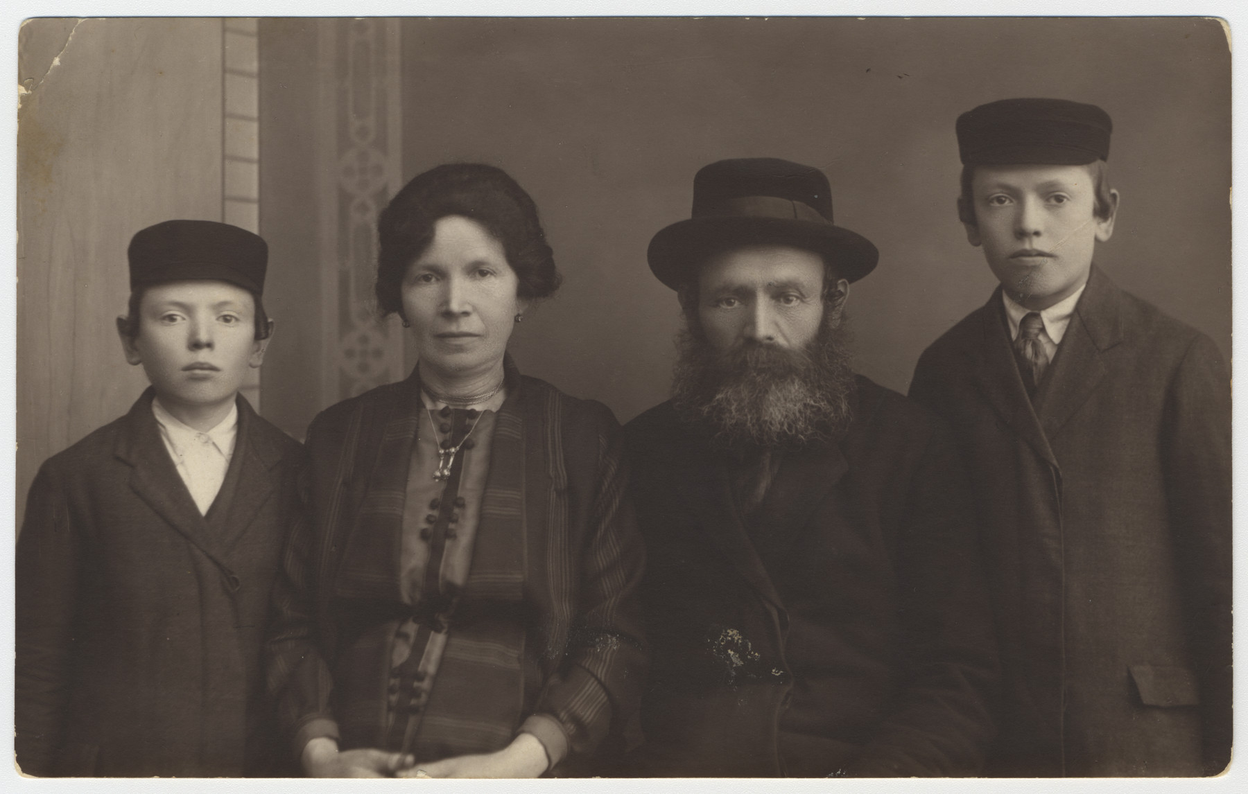 Portrait of an orthodox family in Oswiecim.  Pictured from left to right are Hirsh, Malka, Yehuda and Moshe Krieser.  All of them perished in the Holocaust.
