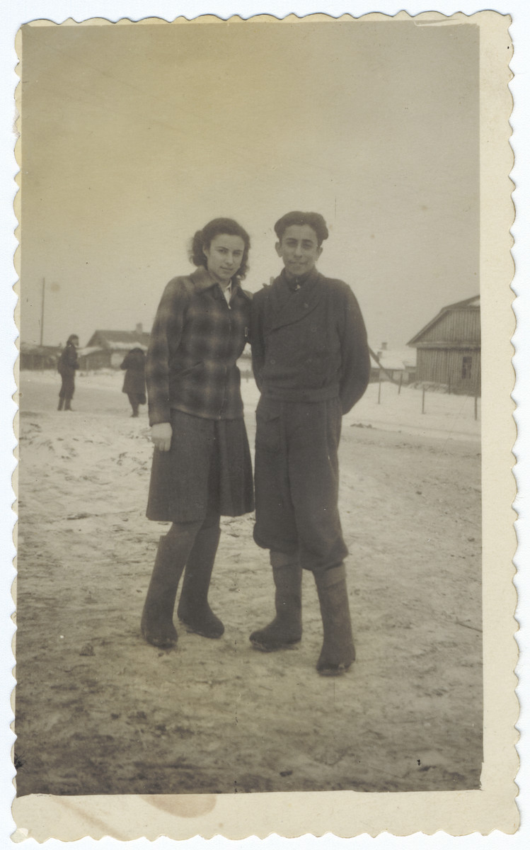 Two Jewish siblings pose together on a snowy field in Siberia.  Pictured are Rina and Reuven Ilgovsky.
