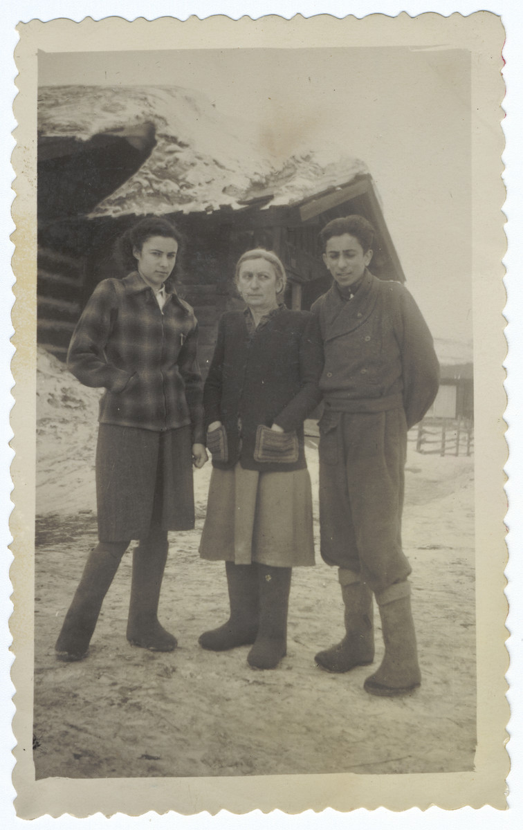 A Jewish family poses together on a snowy field in Siberia.  Pictured are Rina, Hadassah and Reuven Ilgovsky.