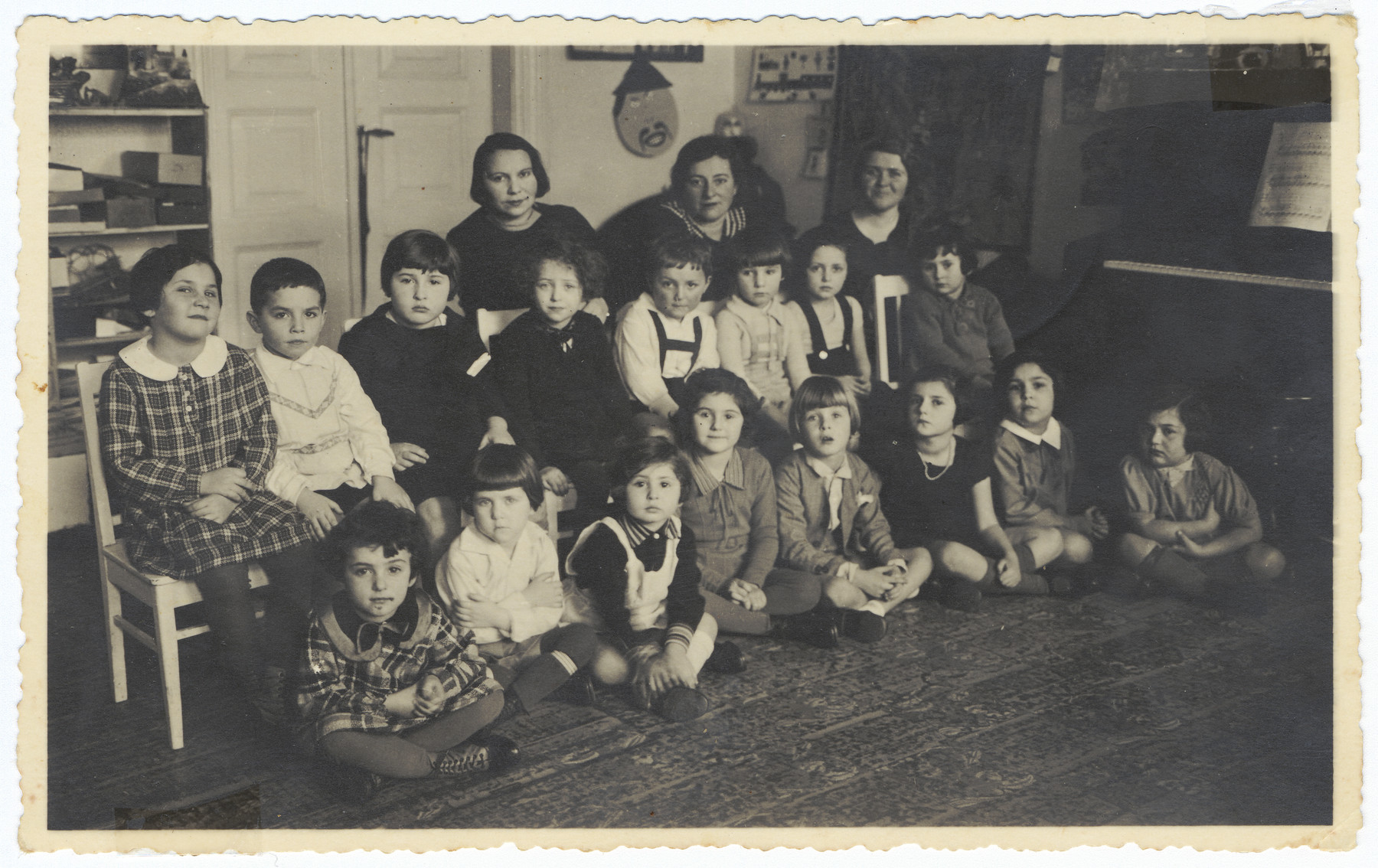 Class photograph of a kindergarten/nursery school in Kaunas.  Among those pictured are Rina Ilgovsky (front corner), Golda Rudashevsky (second row, second from the right) and the teacher, Anna Warshavsky.