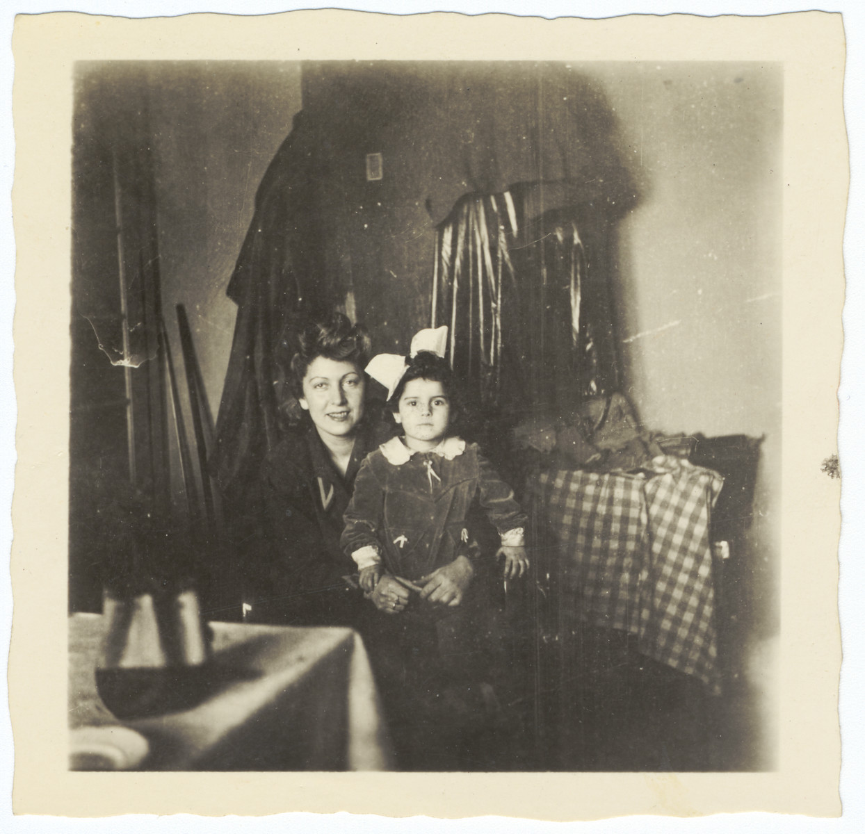 A Jewish woman visits her niece (who later became her adopted daughter) while she is in hiding.  Pictured are Sara Kuniegis and Krystyna Lindenbaum.
