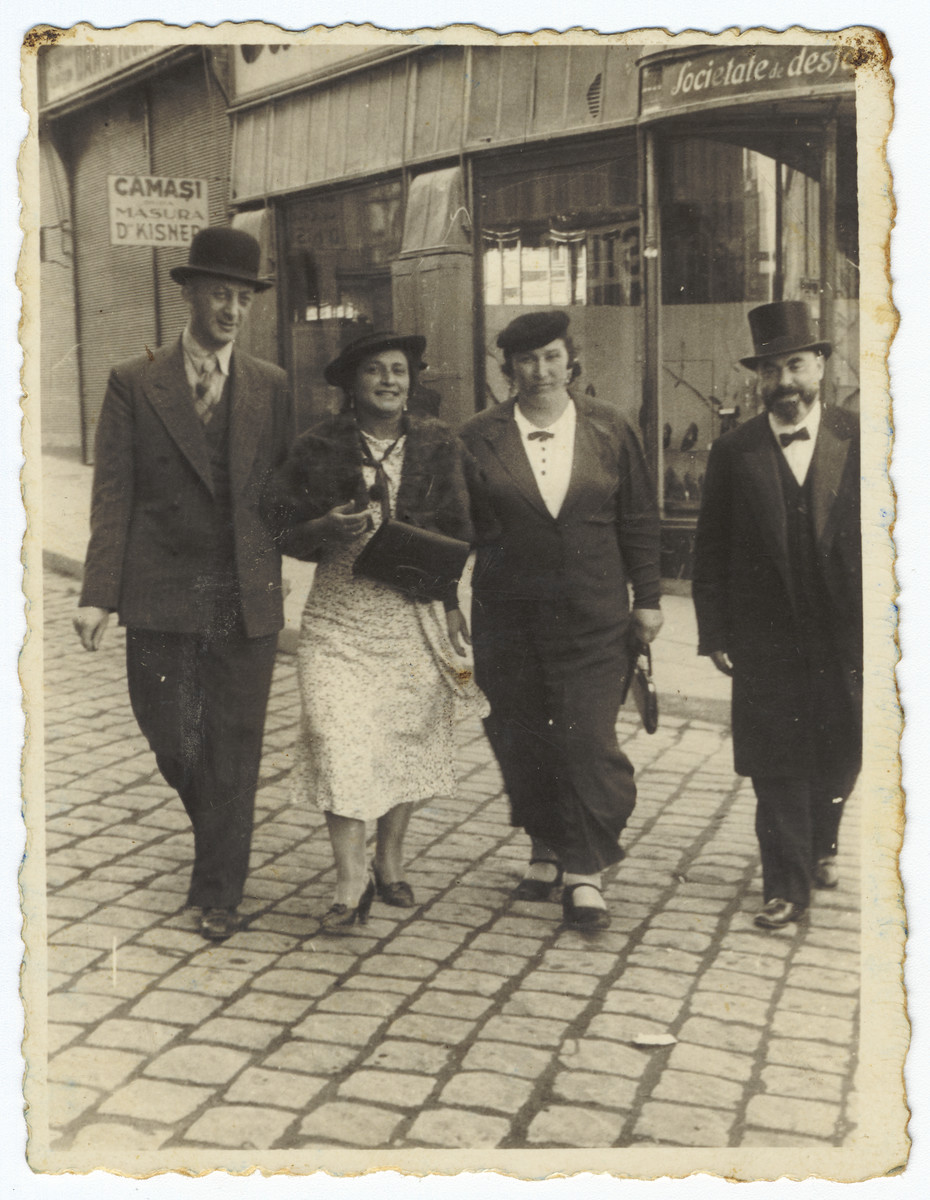 A Romanian Jewish couple walks to the synagogue together with the rabbi and his wife.  Pictured are Baruch, Shneur and Slima Engler and Rabbi and Mrs. Abraham Mark.  Rabbi Mark was shot and killed shortly after the German invasion of Romania in 1941.