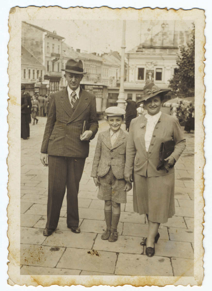 A Romanian Jewish family walks to the synagogue on a Saturday morning.  Pictured are Baruch, Shneur and Slima Engler.