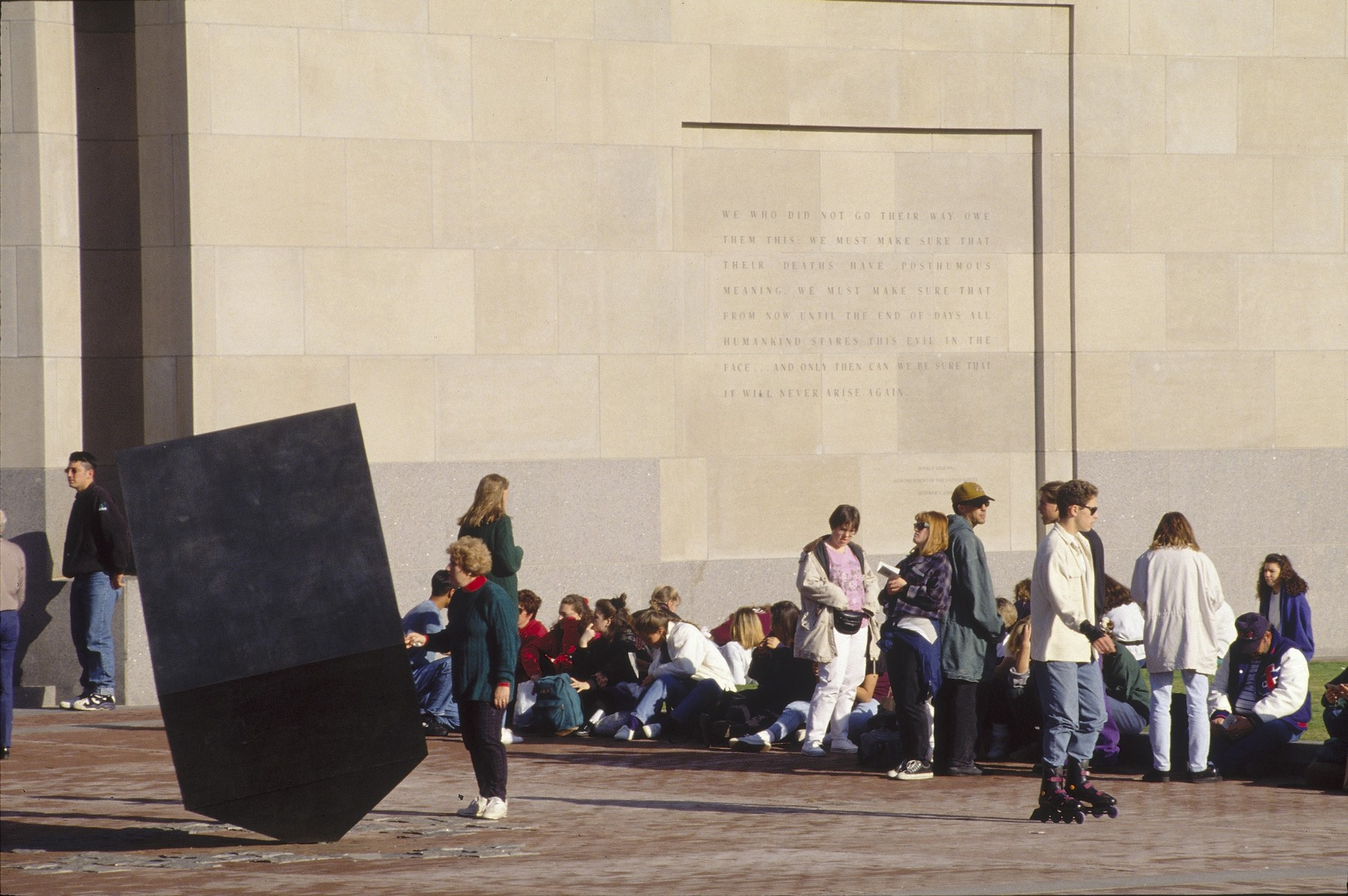 Visitors wait outside the 15th Street entrance to the U.S. Holocaust Memorial Museum.