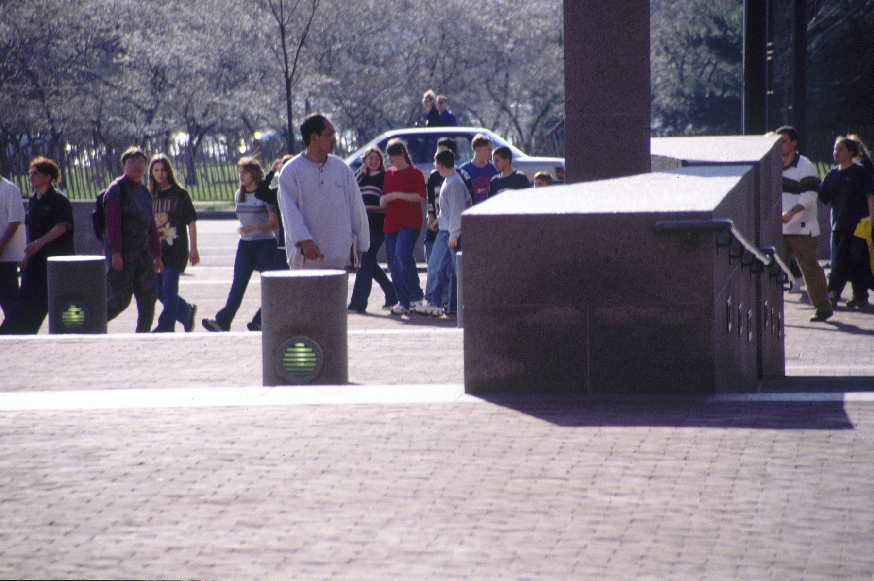 Visitors enter the Eisenhower Plaza in front of the U.S. Holocaust Memorial Museum.