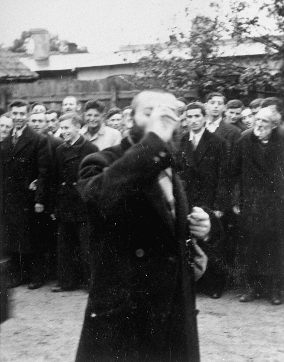 A religious Jew is publicly humiliated in the town square of Raciaz.