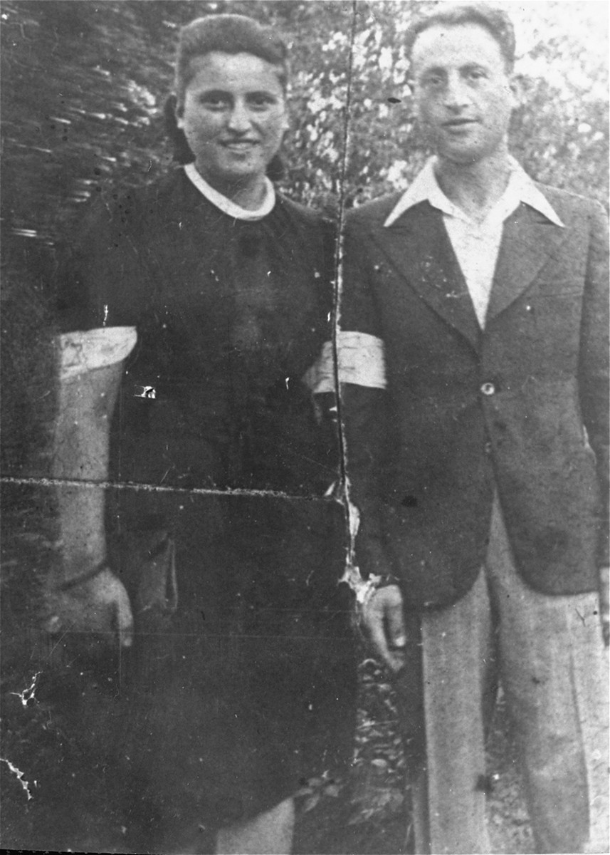 Portrait of a Jewish sister and brother wearing armbands in the Rzeszow ghetto.  Pictured are Moniek and Minia Heber.