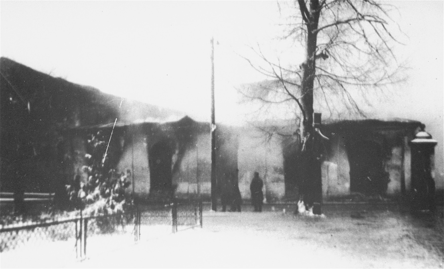 German soldiers view the burning of a synagogue in Siedlce.