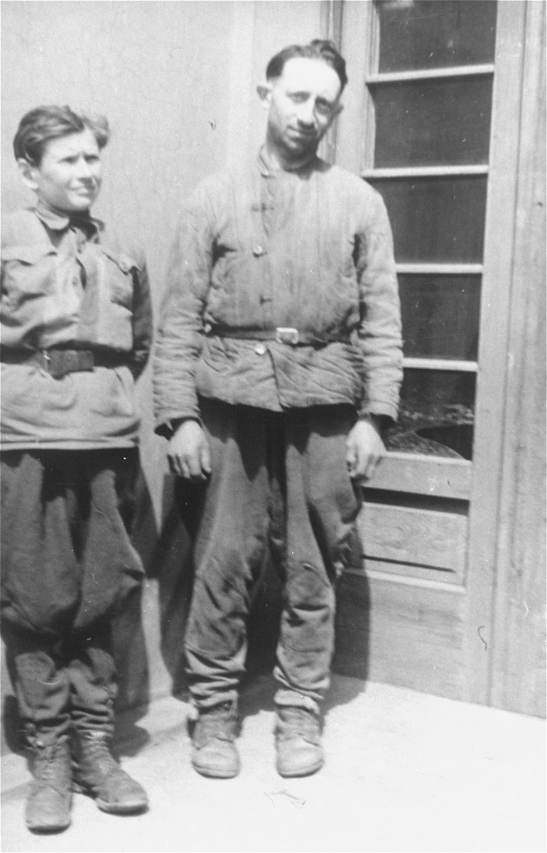 Lyba Leibowicz (right) poses with Jozek Hodor (left) in Rzeszow.  Lyba Leibowicz was a Jewish trapper who was a member of the partisan group that Naftali Saleschütz joined in the forests near Kolbuszowa.  Jozek Hodor was the son of Jan Hodor, a Polish peasant who provided food for the Jewish partisans.