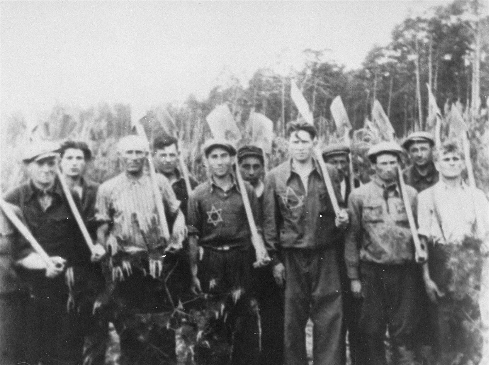 Jews in a forced labor brigade pose holding shovels in the village of Piotrkow Kujawski.