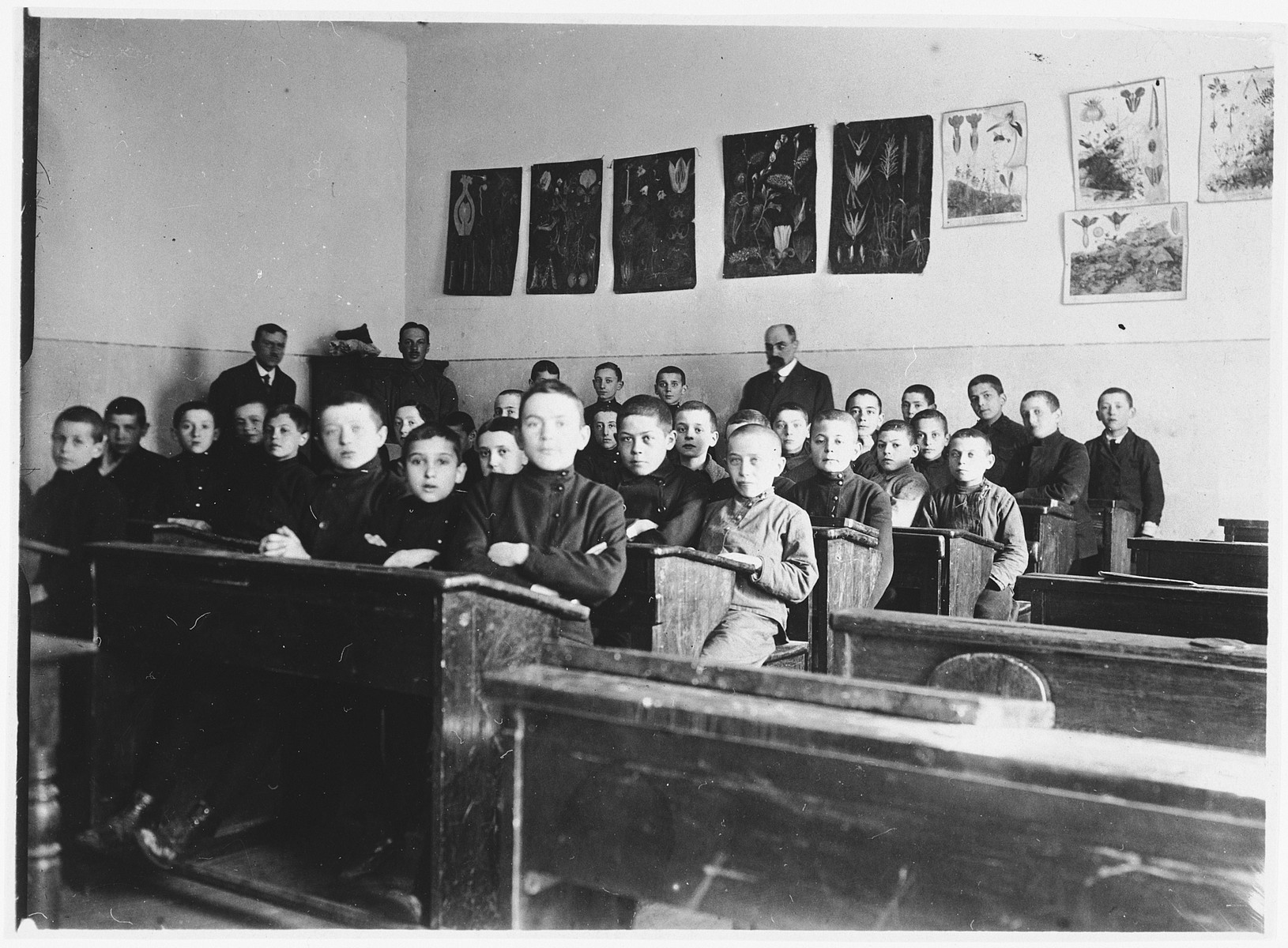 Class of the Hebrew Gymnasium in either Vilna or Grodno.  The teacher, Chaim Arye Chasan, is standing at the back.