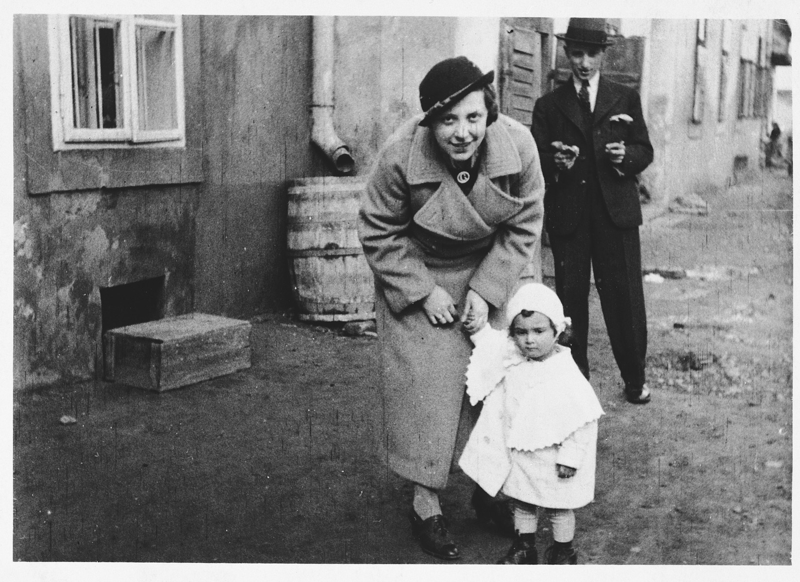 Grete and Eugene Kovacs pose on a street of Galanta together with their one-year-old niece Erika Taubner.