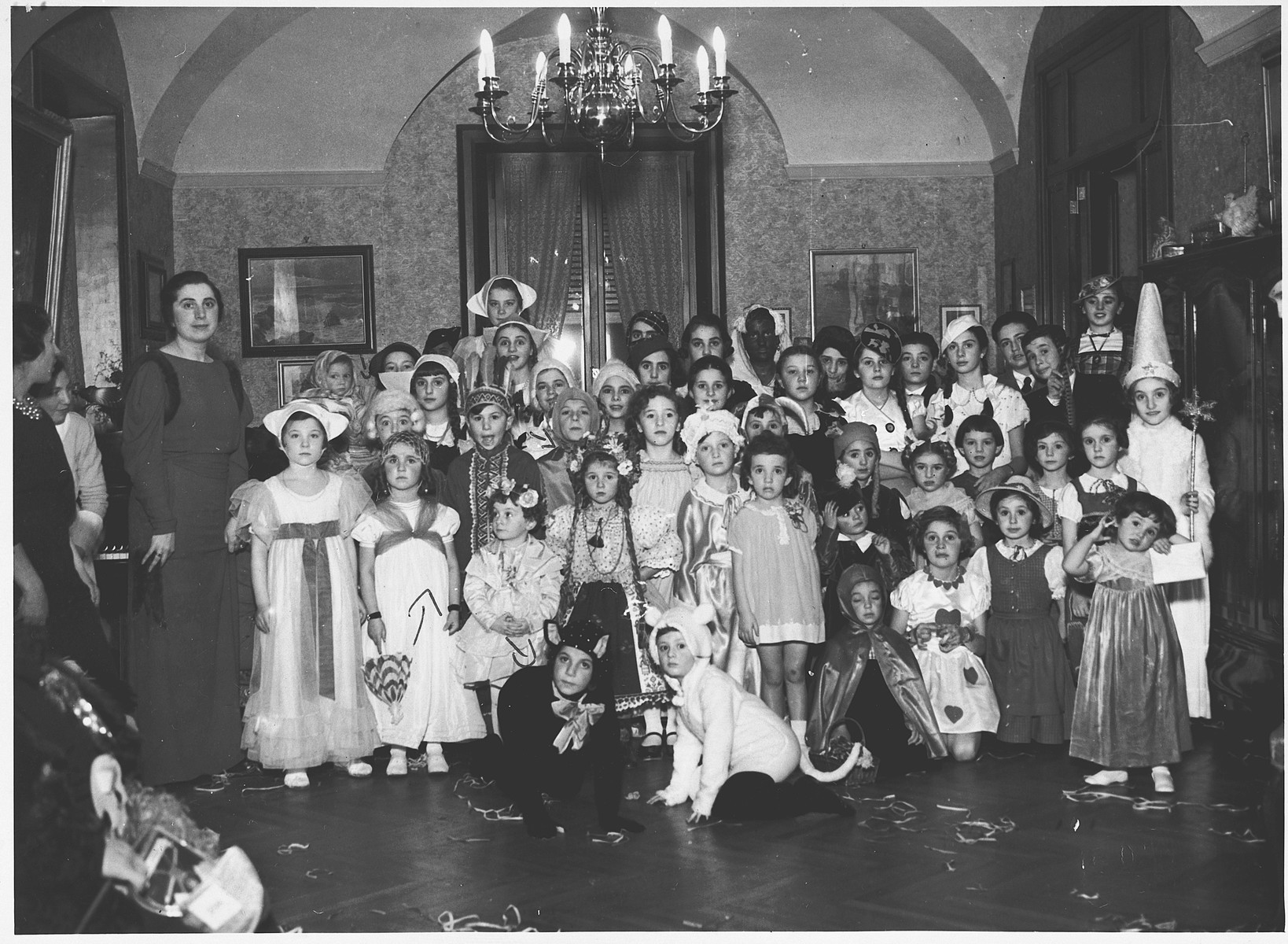 Jewish children attend a Purim costume party in an opulent apartment in Rome owned by a Hungarian Jewish woman.  Among those pictured are Serenella and Avishua Foa and their cousins, Anna and Andrea Bises.