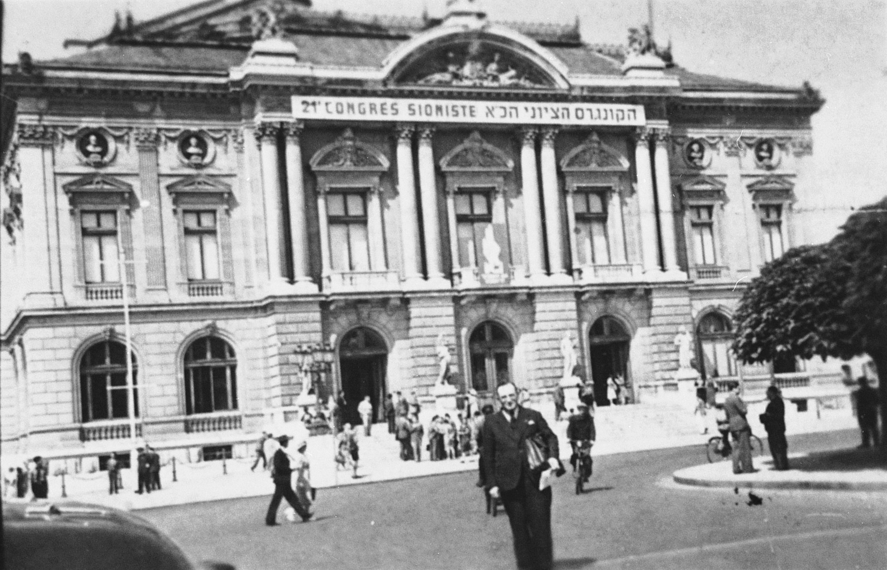 Isaac Margosis, editor of the Yiddishe Woch, stands outside the Grand Theatre in Geneva, the site of the 21st Zionist Congress.
