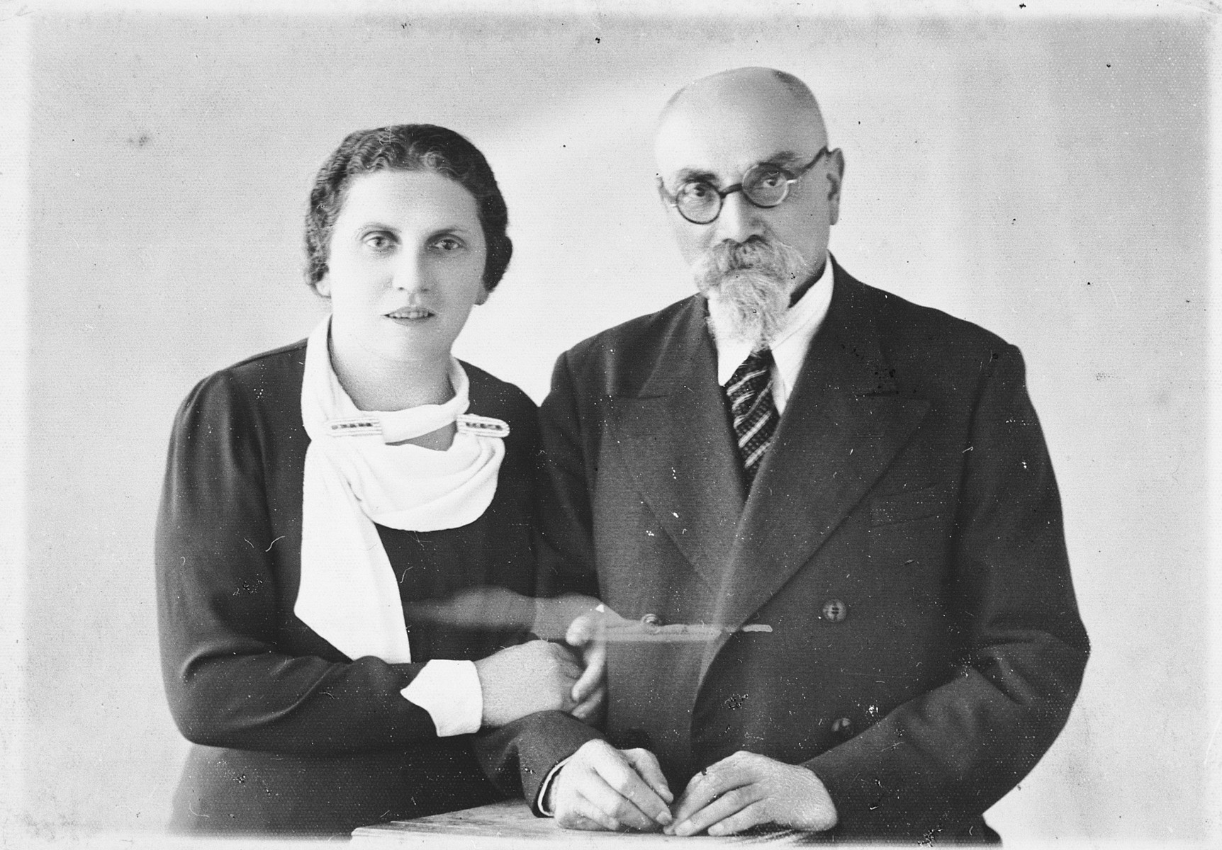 Studio portrait of Miriam Lipert and her father, Chaim Arye Chasan, taken on occassion of her visit from America.