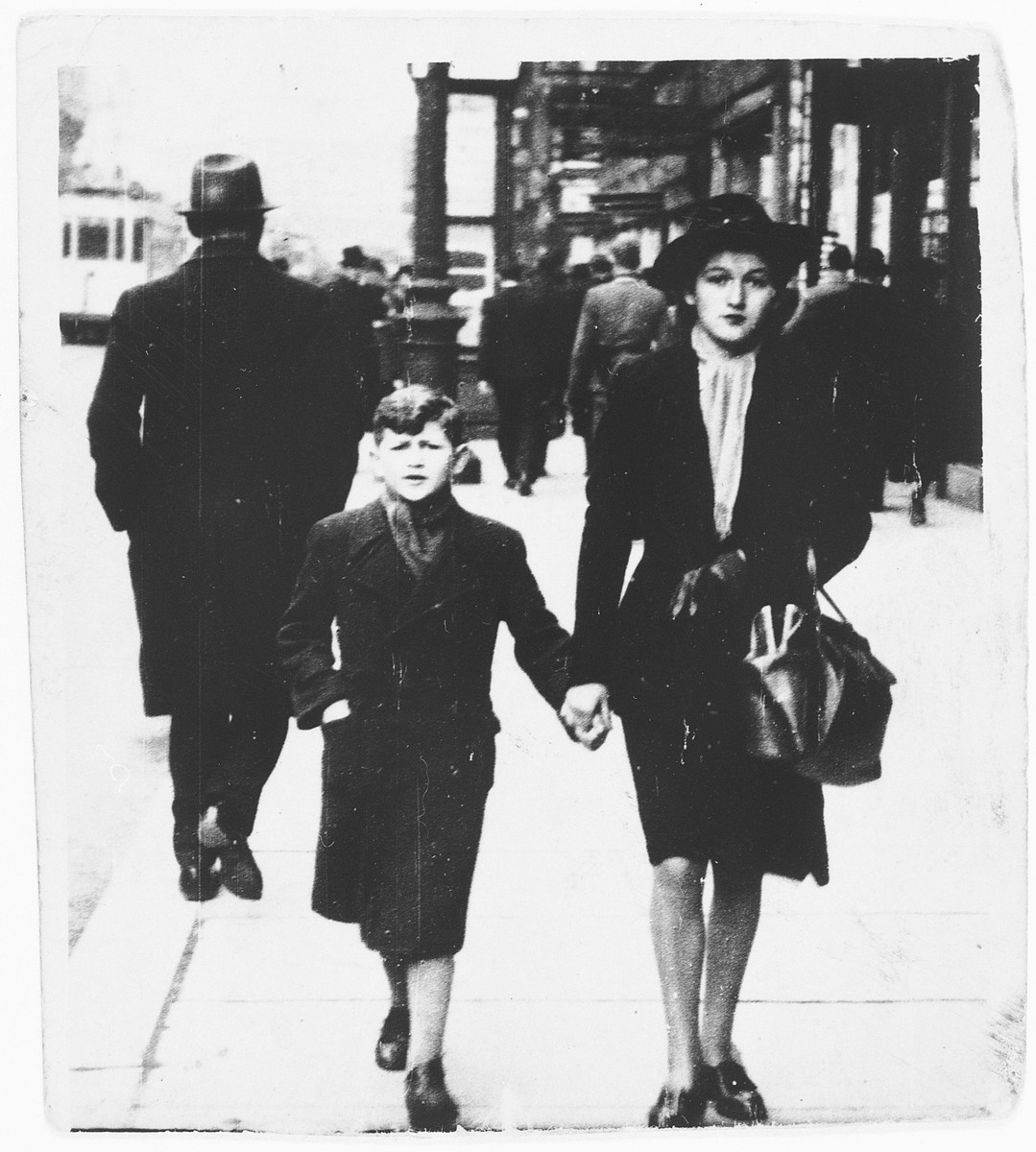 A Jewish brother and sister walk along a street in Brussels, Belgium.  Pictured are Henri and Clara.  This is Henri's last photograph of his sister prior to her arrest and deportation.