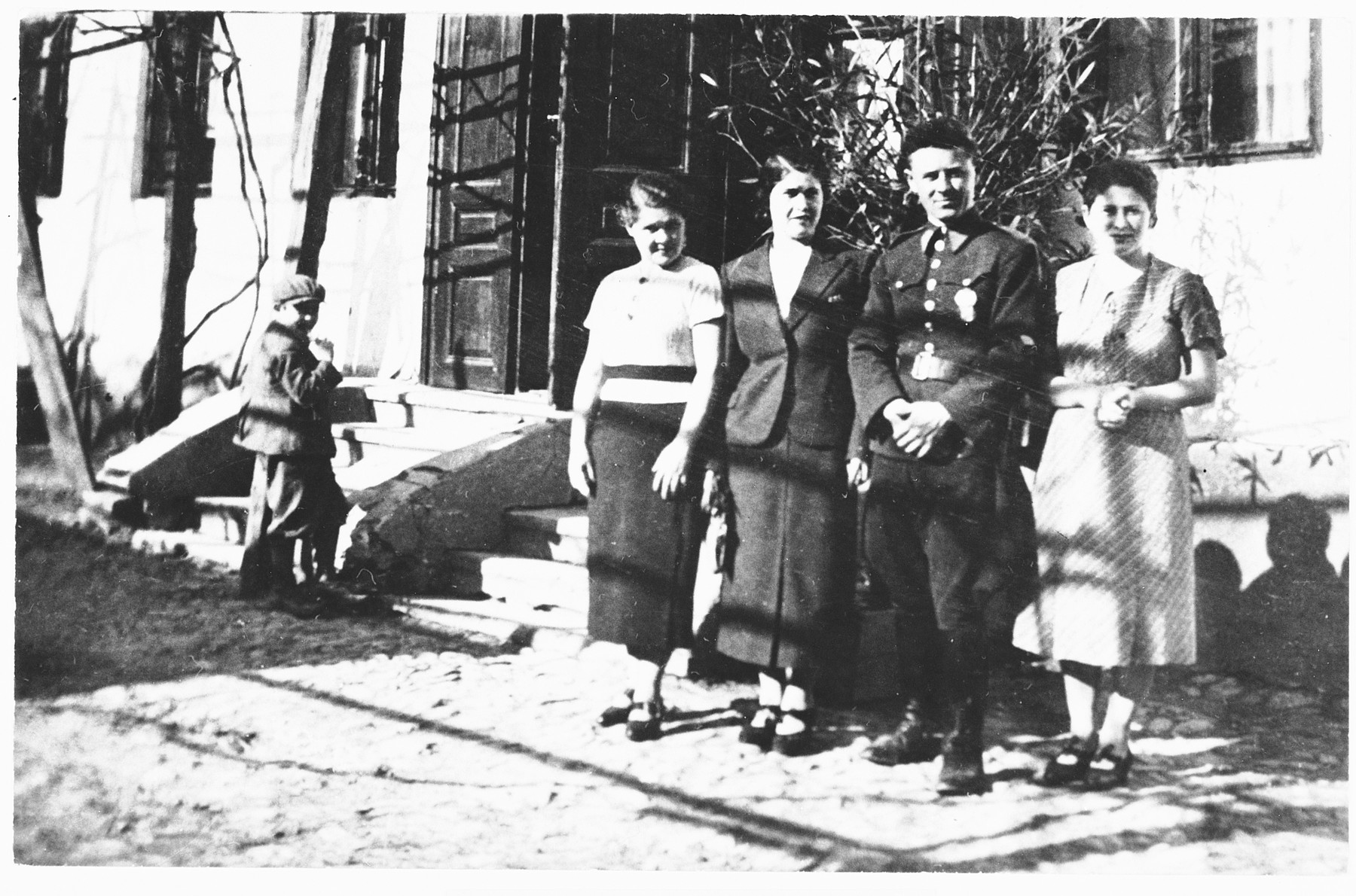 Josef Weinberger poses in his army uniform with his girlfriend and two sisters outside the family's house in Mukachevo.