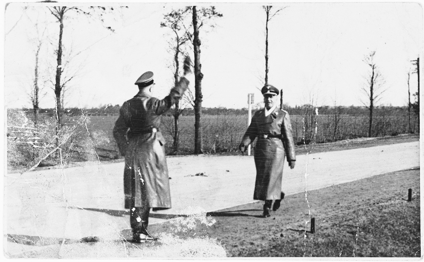 Two SS officers greet each other in the Dachau concentration camp.  Pictured is SS-Obersturmbannfuehrer (Lieutenant Colonel) Martin Weiss (1905-?), commandant of Majdanek from September 1943 to May 1944.