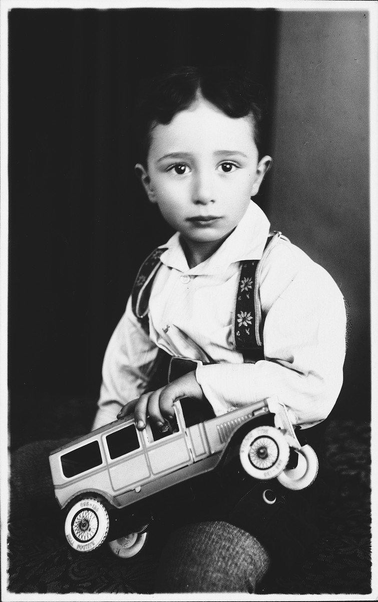 Studio portrait of Laszlo Kovacs (the cousin of the donor) with a toy car.  He later perished in Auschwitz.