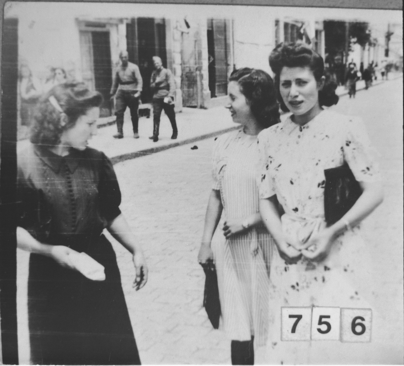 Three young women walk along a street in Bitola.  [Daughters of Haim Nachmias].