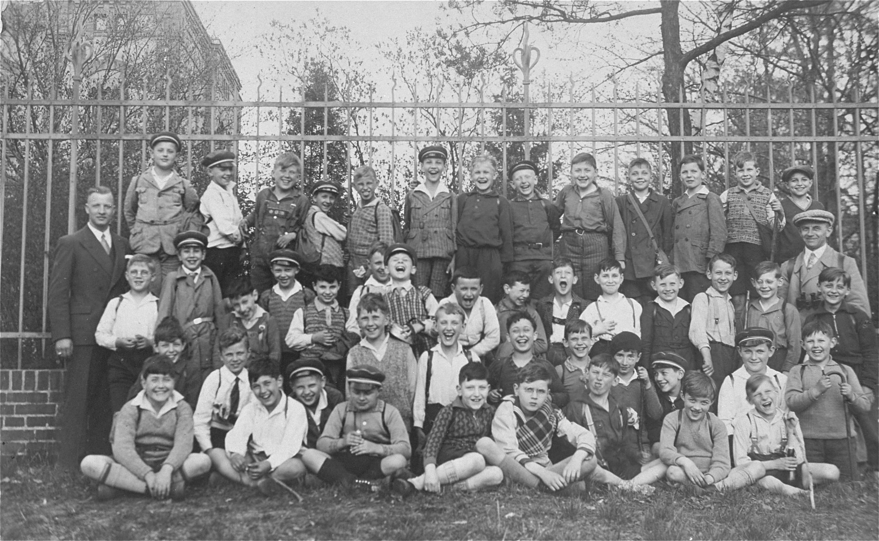 School children pose for a group portrait.  Peter Victor is among them.