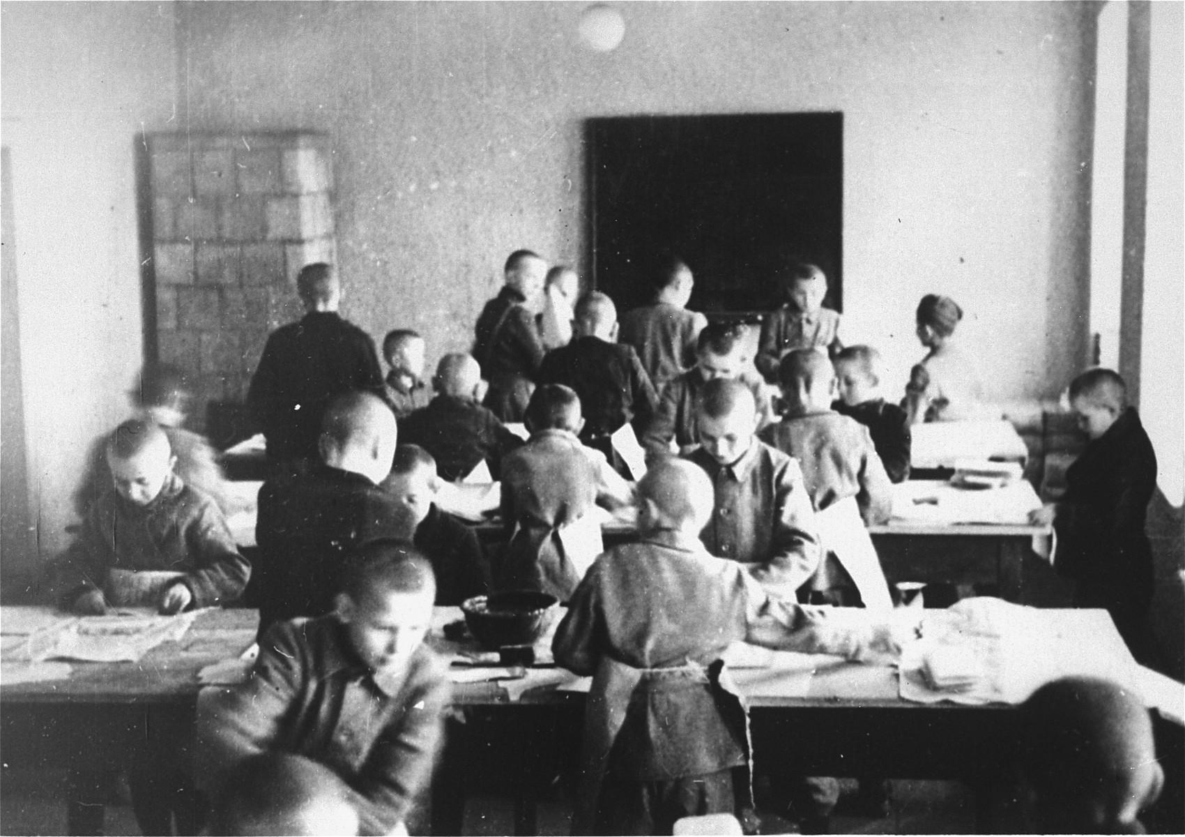 Young Polish children work in a workshop in the Jugendschutzlager Litzmannstadt.