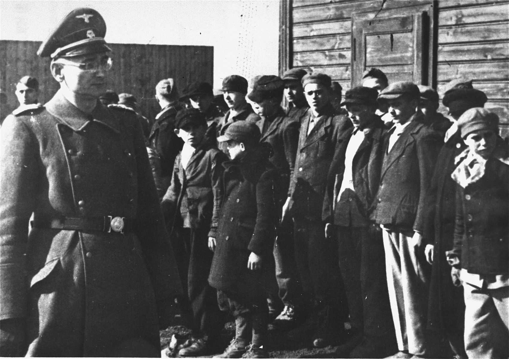 Camp commandant Karl Ehrlich reviews the child prisoners at his camp.