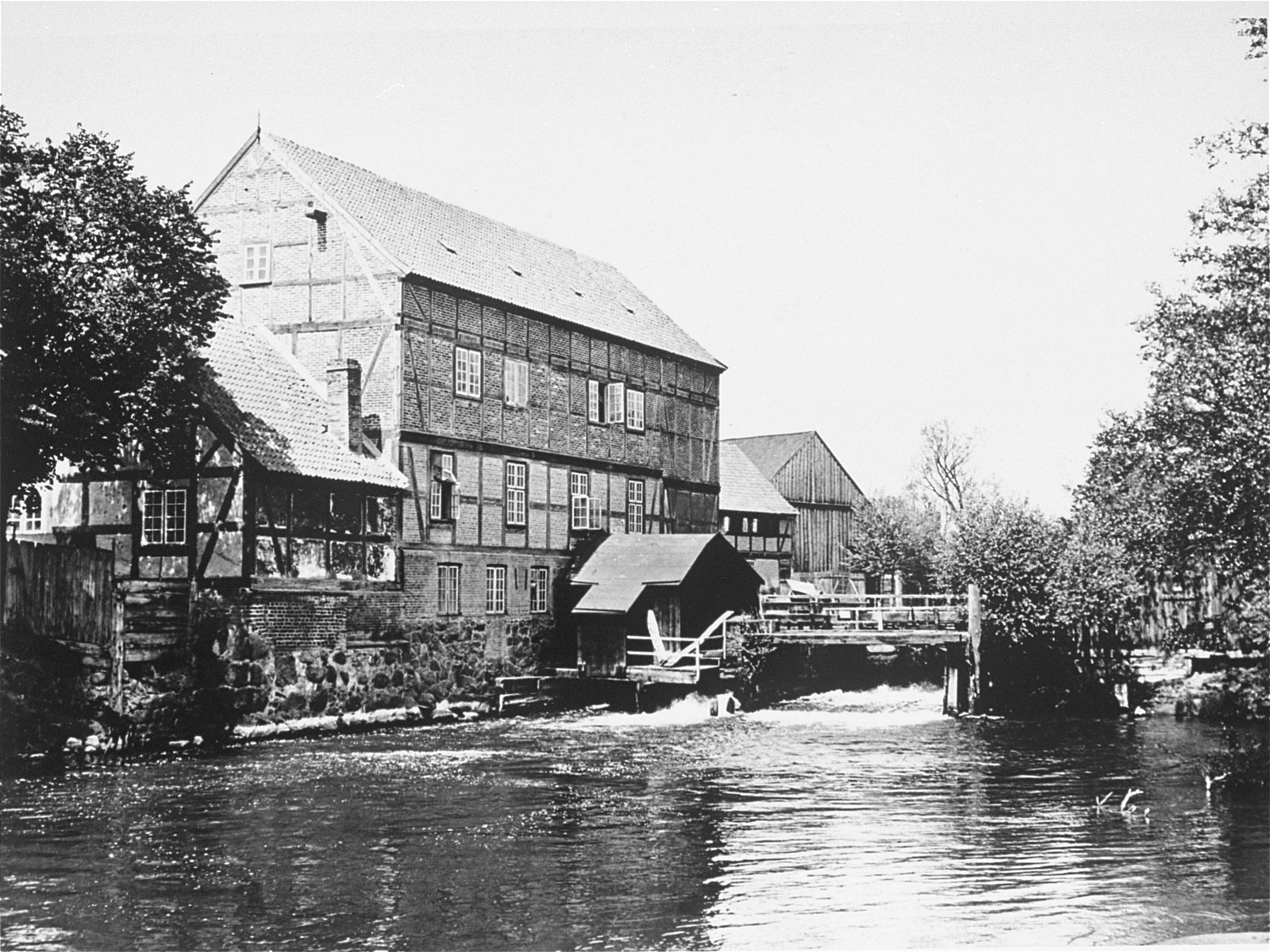 View of the Schlawer Muhlenwerke, a mill owned and operated by Hugo Gottschalk.    The mill was founded in 1872 by Benjamin Gottschalk (1834-1902).  His son, Hugo, took over the mill after his death.  The mill remained in the hands of the Gottschalk family until 1923, when it was sold to the city of Schlawe.