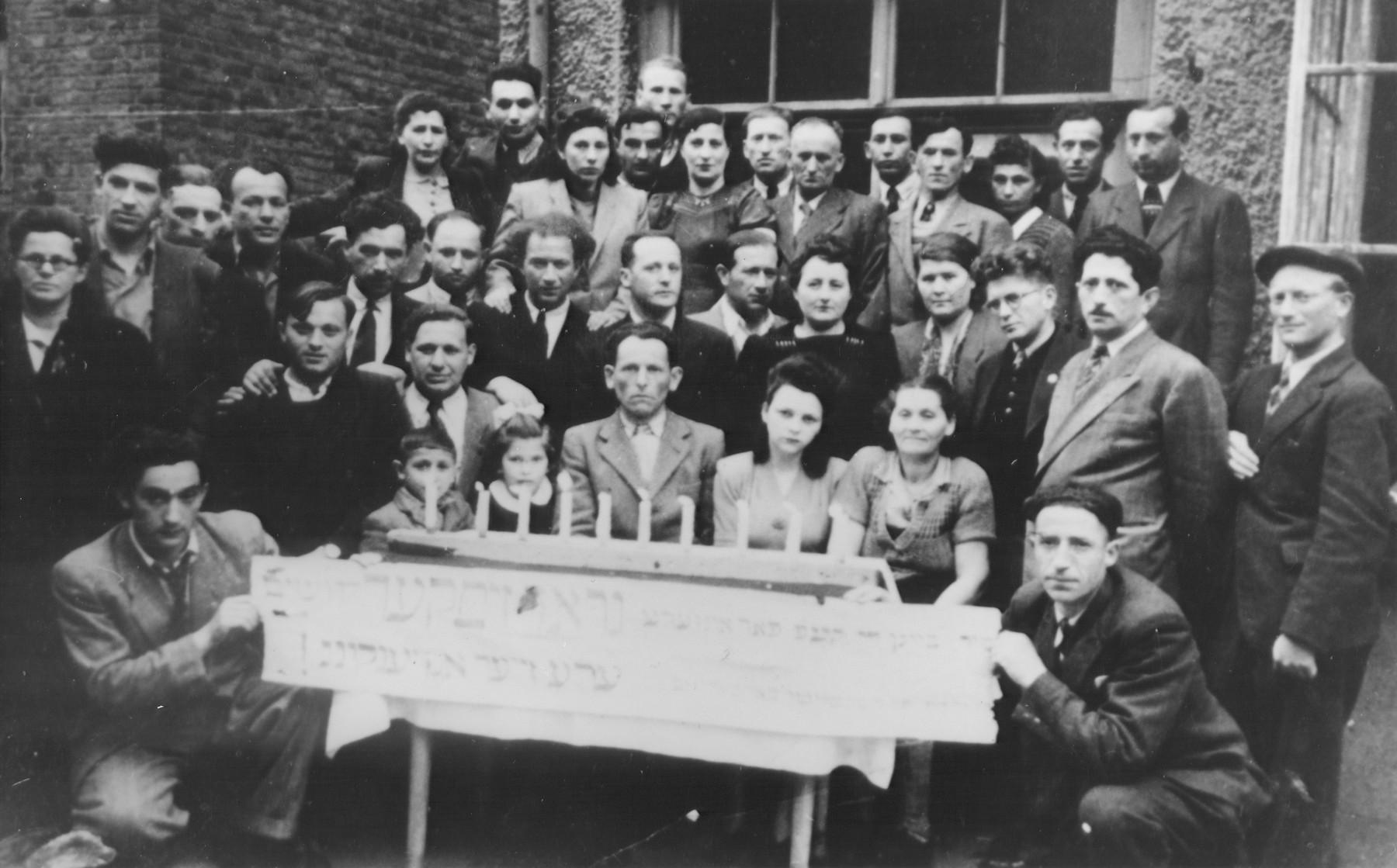 Memorial to the Jews who perished in Grodzisk Mazowiecki.  Those pictured include Mojsze Apfal, Eli Wigdor Wajcer, Lajbus Kamerfuks, Mojsze Korcarz, Mala Friedman, Kalman Wajcman, Lajbus Grossmann, Herszl Wajnberg, Majer Horn, Gedalia Srebruik, and Gucia Liphaber.