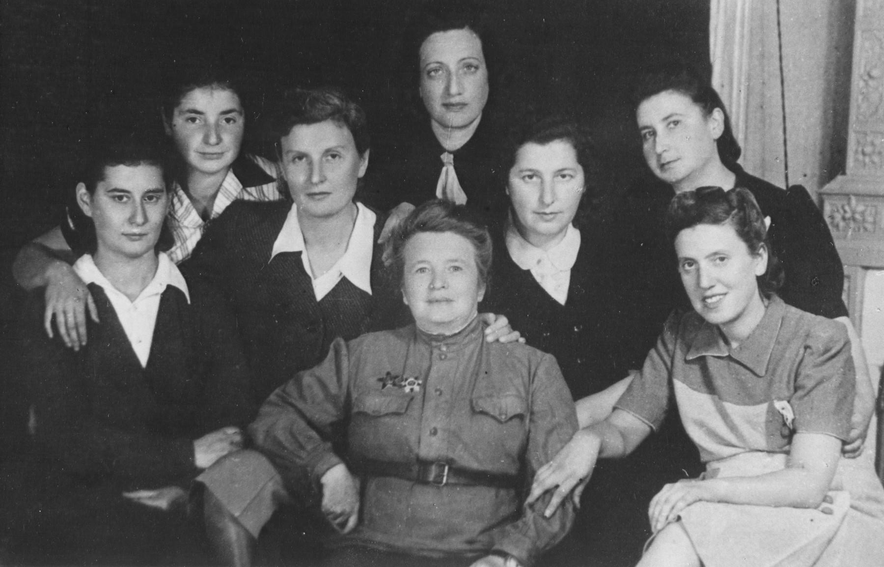 A group of female Jewish survivors pose with Dr. Nisenevitch, a Soviet army physician who befriended them and nursed them back to health.  Pictured are Fanya Szuster, Ita Shapiro, Katia Magid, Grossman and Diamentman, and Dr. Nisenevitch (center front).