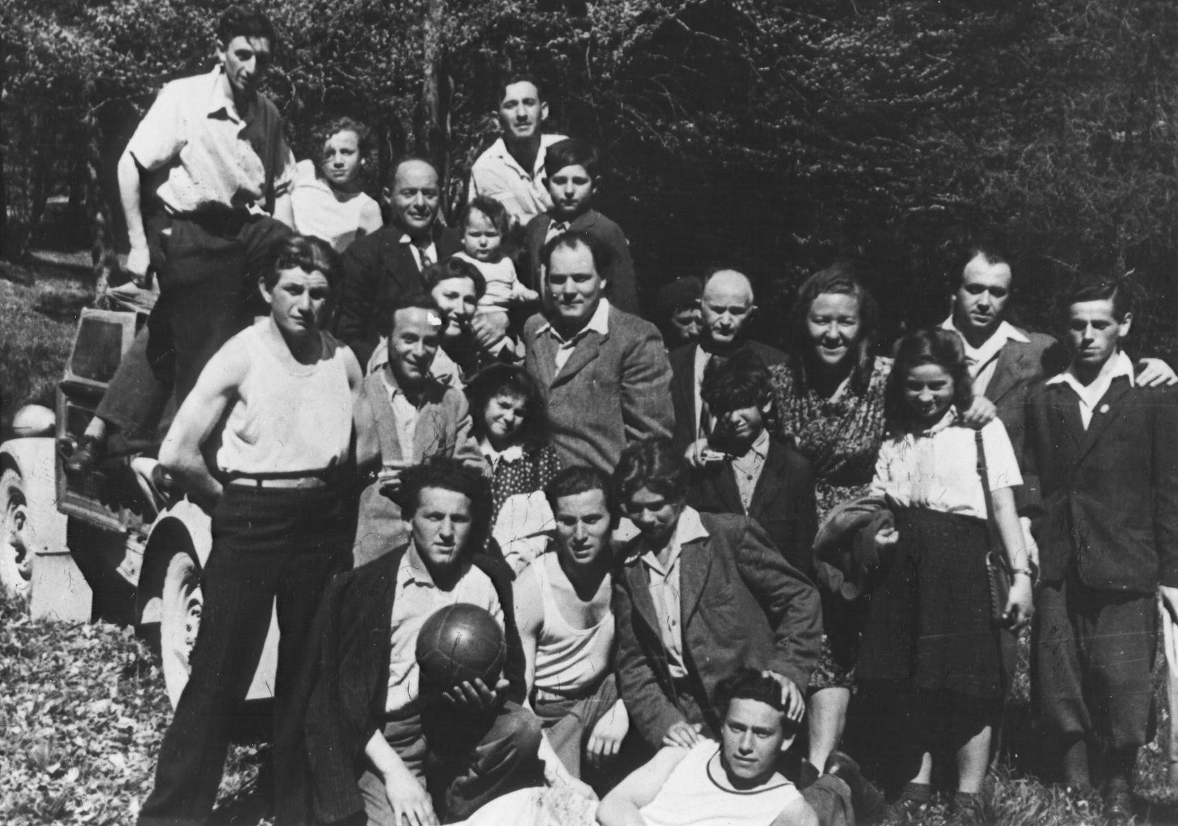 Group portrait of several families in the Feldafing DP camp.