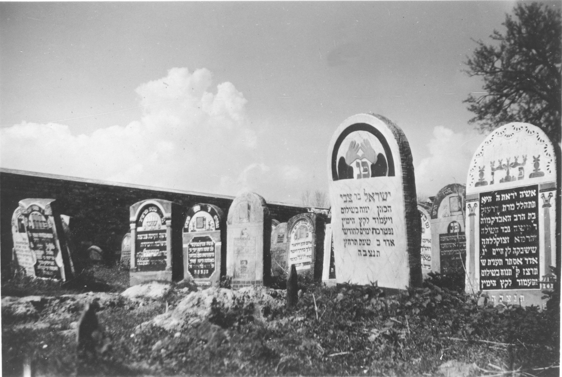 View of tombstones in a Jewish cemetery.  [Though the photograph was taken during the war, the tombstones are prewar.]