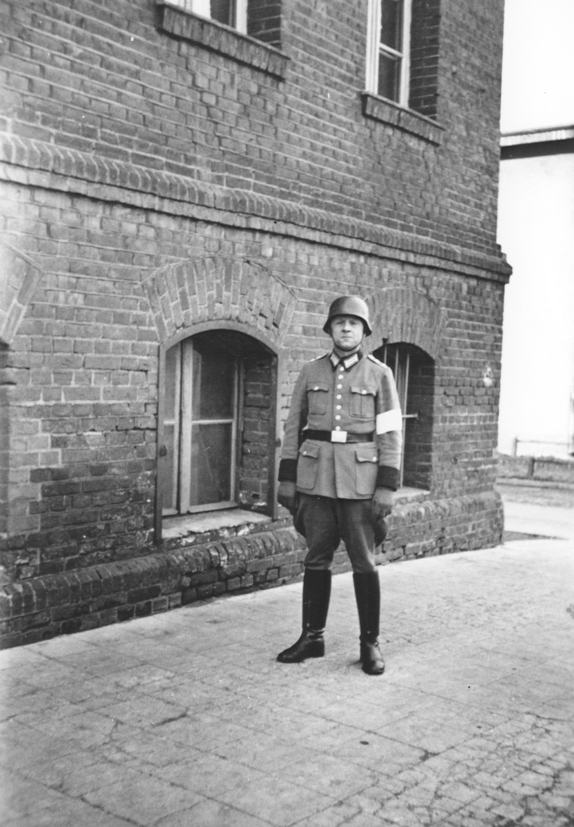 Police Seargent Joef Herkert stands outside a building probably in Wuerzburg.